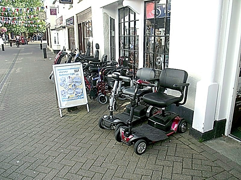 Mobility Scooters outside a shop