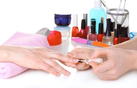 Applying nail polish during a manicure