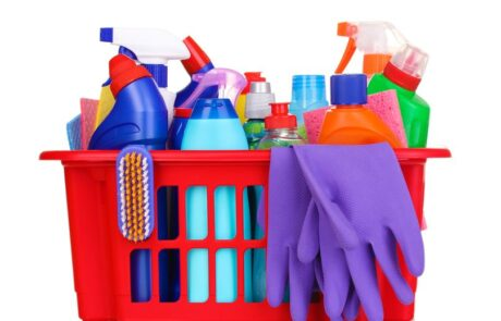 Cleaning items in red plastic basket